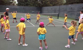 Hosley_stretches_out_superhero_kids_camp_for_tennis_2014